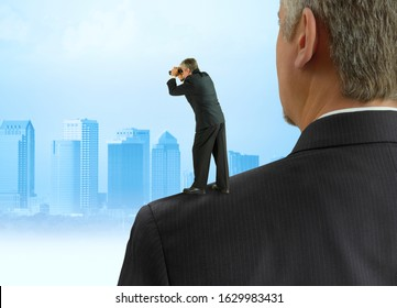 Man with binoculars looking forward standing on the shoulders of giants concept with cityscape representing benefitting from previous work by past people, stock market forecasting, progress & success.