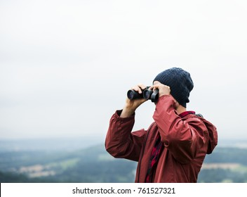 Man Binoculars Looking Mountain Cloudscape Traveling Concept