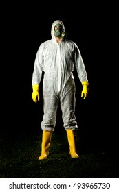 man in bio hazard protective suit with gas mask and gloves