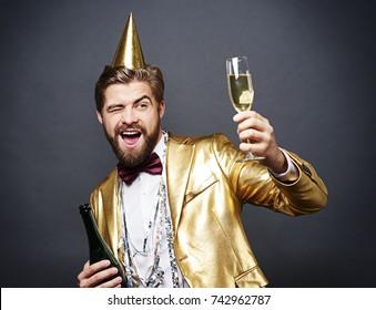 Man with birthday hat toasting
