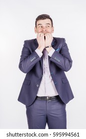 man biting his nails fingers freaking out. human emotion expression and lifestyle concept. image on a white studio background.