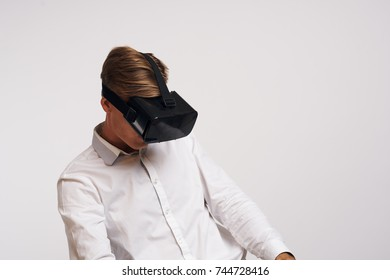 man in black 3d glasses on a light background, virtual reality