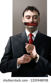man with black censored tape on his face