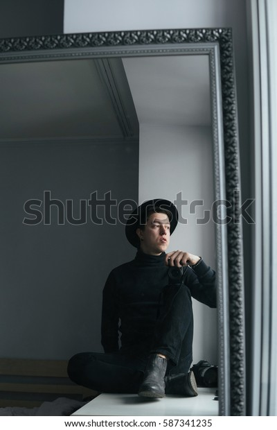 man in black clothes photographed himself in the mirror