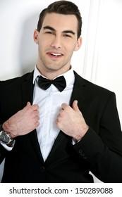 Man in black dinner jacket with bow tie. Bridegroom