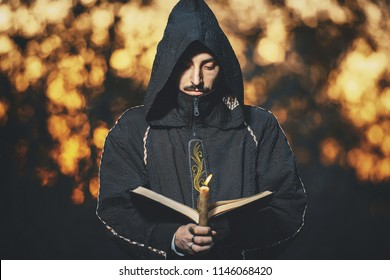 The man in the black hood. Cosplay of the Black Magician. Male Warlock
