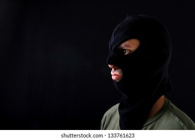 A man with a black mask, burglar