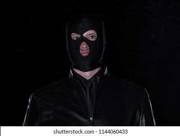 a man in a black mask on a black background