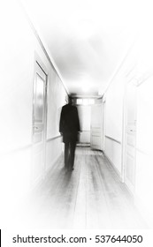 Man in black, motion blur, walking in a white hospital corridor.