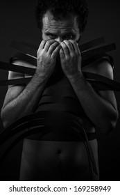 Man with black shapes, studio portrait