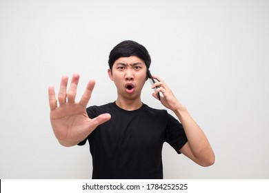 Man black shirt holding smartphone show hand stop say no serious on white isolated background