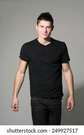 Man in black shirt on grey background