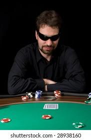 Man in black shirt playing poker in the casino