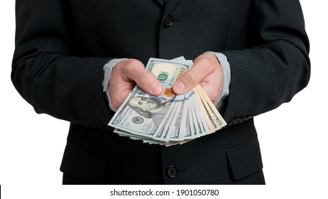 Man in black suit holding fan of cash money close up isolated on white background