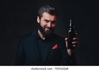 A man in a black suit presenting craft beer.