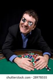 Man in black suit take a jackpot in casino