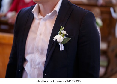 man in black suit and white shirt with a flower...