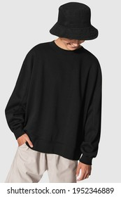 Man in black sweater and black bucket hat youth apparel shoot