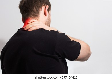 man in black t shirt holding her painful  neck, back, experiencing pain,  red spot,  Sport injury, tired office work, on the white