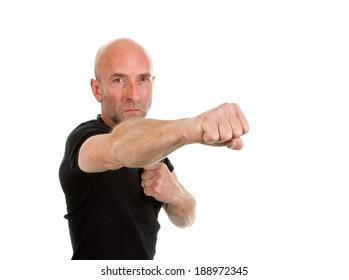 Man in black tee-shirt throwing a punch