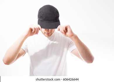 the man, in the blank black, baseball cap, snapback  on a white background, mock up, free space, logo presentation , template for print,  design,