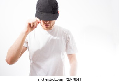 the man, in the blank black, baseball cap, snapback  on a white background, mock up, free space, logo presentation , template for print,  design