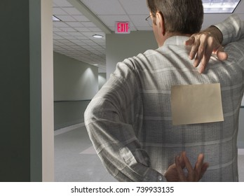 man with blank note on back in hallway