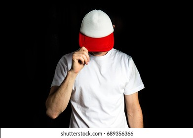 man in the blank white, red baseball cap and white t shirt, on a black background, mock up, free space, logo presentation , template for print,  design