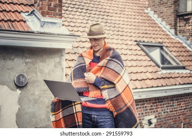 Man with blanket on the roof.
