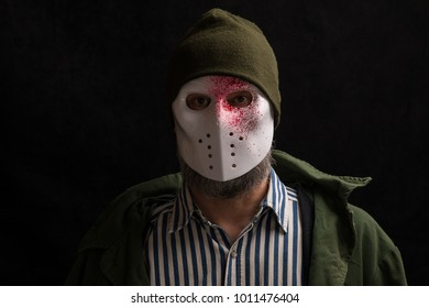 a man in a blood mask, a mask of a murderer