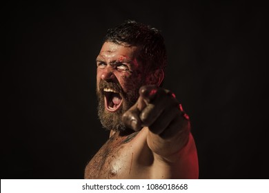 Man with bloody beard, angry face point finger on black background. Wizard, sorcerer, warlock. Magic, enchantment, witchcraft. Halloween holidays celebration