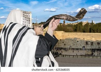 Man blowing Shofar horn for the Jewish New Year holiday (Rosh Hashanah)/Shofar at the Kotel/ Man blowing Shofar horn for the Jewish New Year holiday (Rosh Hashanah)