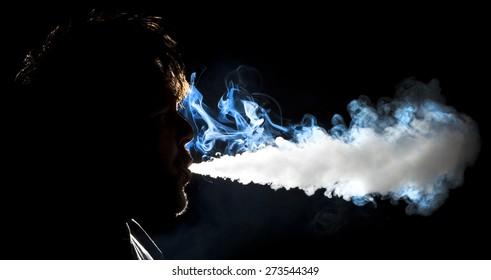 Man blowing vapor cloud from an E-Cigarette