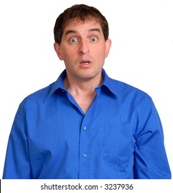 Man in blue dress shirt looking surprised.