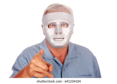 A man with blue eyes in a Generic Silver Mask. Isolated on white. Room for text.