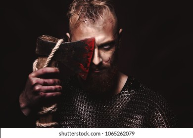 The man with blue eyes, white hair, red beard, Viking