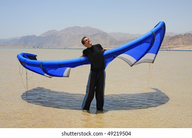 A man with the blue kite.