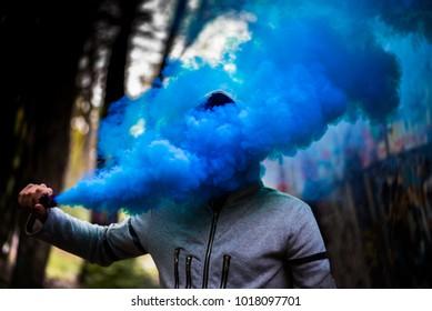 Man in blue smoke grenade
