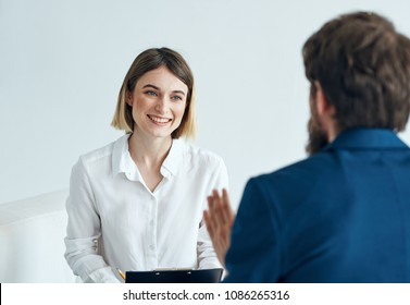 a man in a blue suit, a happy woman at an interview