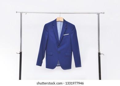 man blue suit on hangers