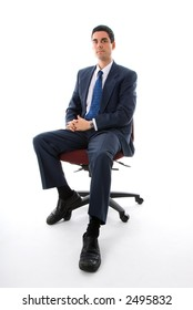 man in blue suit sitting on a chair