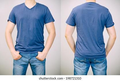 Man in blue t-shirt. Grey background.