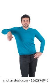 Man in blue t-shirt leaning on an invisible object