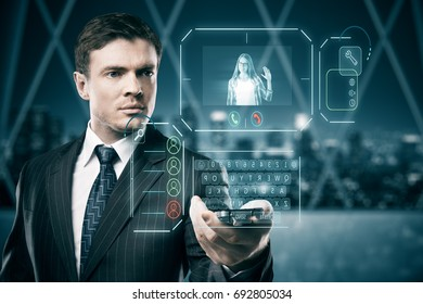 Man in blurry interior communicating with young woman waving at him through abstract futuristic screen hologram. 3D Rendering
