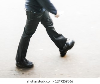 man at blurry walking