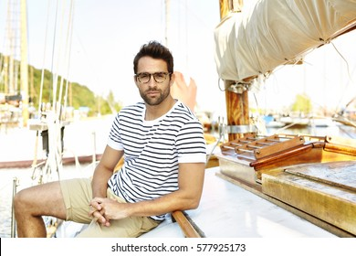 Man in a boat, looking a camera