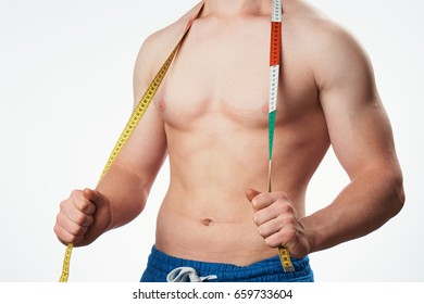 Man with a body meter on a light background
