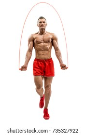 man bodybuilder jumping with jump rope, on white background, isolated