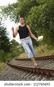 the man with the book goes on rails