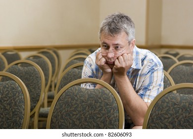 Man at  a boring conference